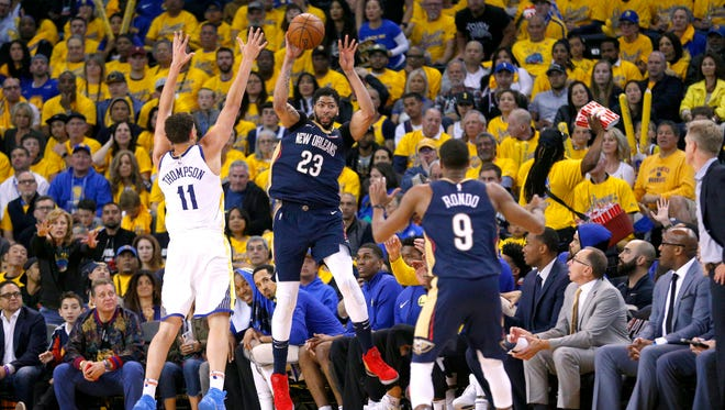 New Orleans Pelicans forward Anthony Davis (23) saves the ball from going out of bounds next to Golden State Warriors guard Klay Thompson (11) in the third quarter in game one of the second round of the 2018 NBA Playoffs at Oracle Arena.