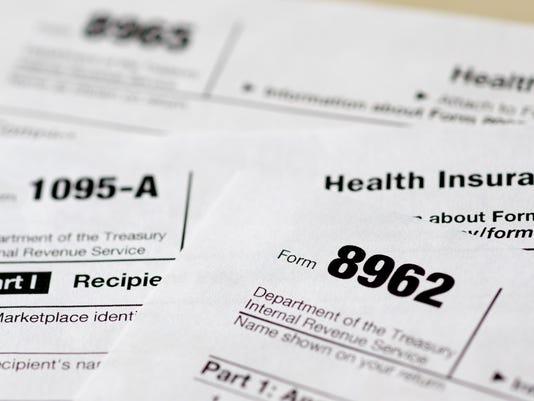 635567837009251067-AP-Health-Overhaul-Penalties