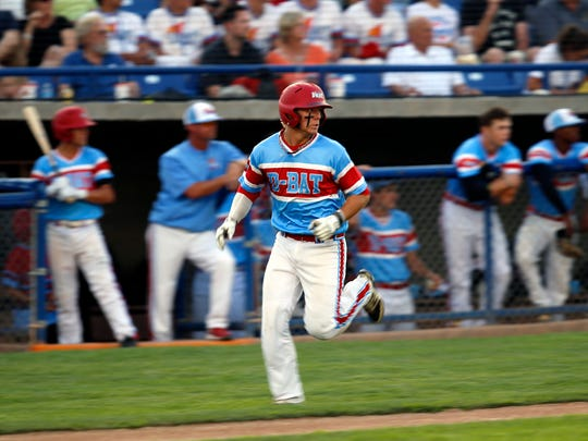 D-BAT Elite 18U's Brian Klein scores a run on Friday