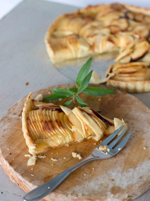 French apple tart with thinly sliced apples. When slicing the apple, stop each slice when you're still about 1/4 inch from the surface of the cutting board. According to chef Sara Moulton, it is easier to slice an apple thinly when each slice remains attached at the bottom.