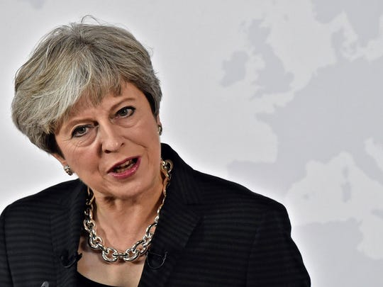 British Prime Minister Theresa May delivers a speech