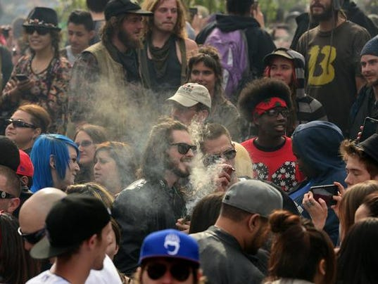 Pot smokers parttake in smoking pot at 4:20 pm on 4/15/2015 in Denver, Colorado
