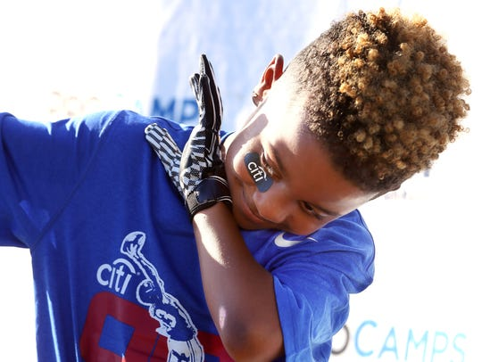 Juelz Chiron-Robinson, 6, of Spring City , PA throws