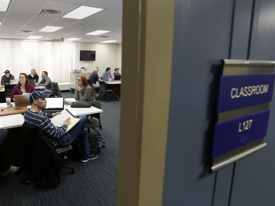 Lakeshore Technical College students attend a class during the evening of April 19, 2018, in Cleveland, Wis. Offering more classes in the evenings and at night are among the ways Wisconsin's technical colleges are trying to keep enrollments up at a time when bright job markets have made student recruitment more difficult.