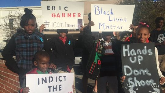 Young protesters joined a rally Sunday in downtown Pensacola.