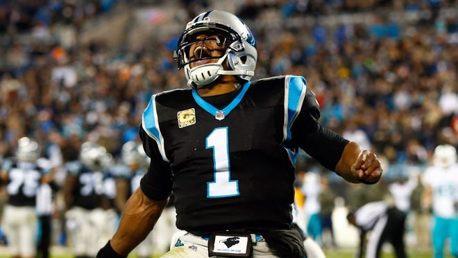 Panthers quarterback Cam Newton celebrates a touchdown during the first half against the Dolphins in Charlotte.