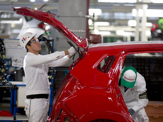 Employees at work in the new multibillion-dollar Honda car plant in Celaya, in the central Mexican state of Guanajuato, Friday, Feb. 21, 2014.