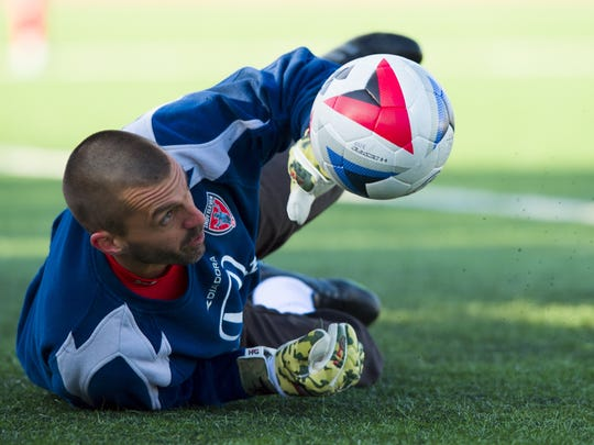 Indy Eleven goalkeeper Jon Busch (18) warms up on the field before the game. The Indy Eleven opened their 2016 season against Ottawa Fury Saturday, April 9, 2016, at IUPUI's Michael A. Carroll Track and Soccer Stadium. The game ended in a 1-1 draw.