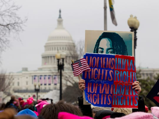 Demonstrators rally on Capitol Hill during the Women's