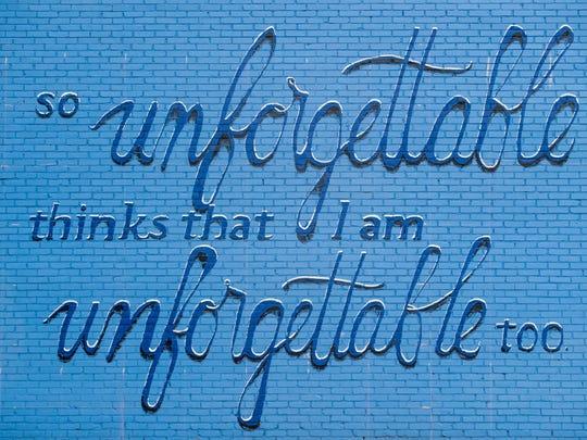 Artists Sunny Paulk and Corey Spearman paint a mural