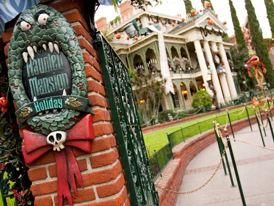 The Haunted Mansion's seasonal overlay, featuring characters