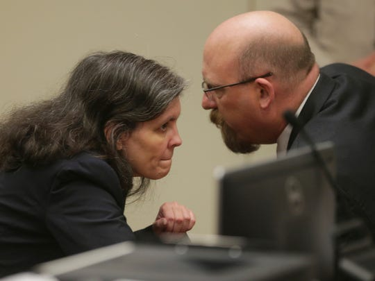Louise Turpin, left, and her attorney, Jeff Moore, appear in court for a conference about their case in Riverside, Calif., Friday, Feb. 23, 2018.
