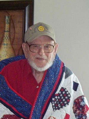 Local World War II Army veteran Cecil Sells is shown with the quilt awarded to him by the Mountain Home Quilts of Valor in a recent ceremony at the Van Matre Senior Wellness & Activities Center