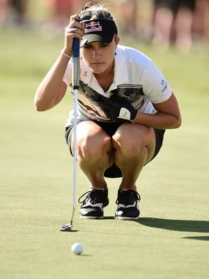Lexi Thompson lines up a birdie putt on the 18th green during the second round of the Meijer LPGA Classic at Blythefield Country Club  on June 16, 2017 in Grand Rapids.