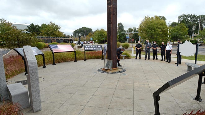 Members of the Erie Bureau of Police, the Erie Bureau of Fire and Mayor Joe Schember gather at the Erie 9/11 Memorial outside Blasco Library in Erie on Friday to commemorate the 19th anniversary of the attacks.