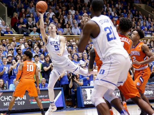 Duke's Luke Kennard (5) drives to the basket during the second half of an NCAA college basketball game against Clemson in Durham, N.C., Saturday, Feb. 11, 2017. Duke won 64-62. (AP Photo/Gerry Broome)