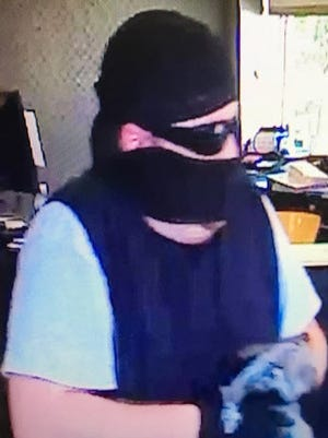 Johnston police are searching for the pictured suspect in relation to a bank robbery at Bank Iowa Friday morning. He is described as a man between 35 to 40 years old. He is around five feet eight inches tall and has light brown bushy hair.