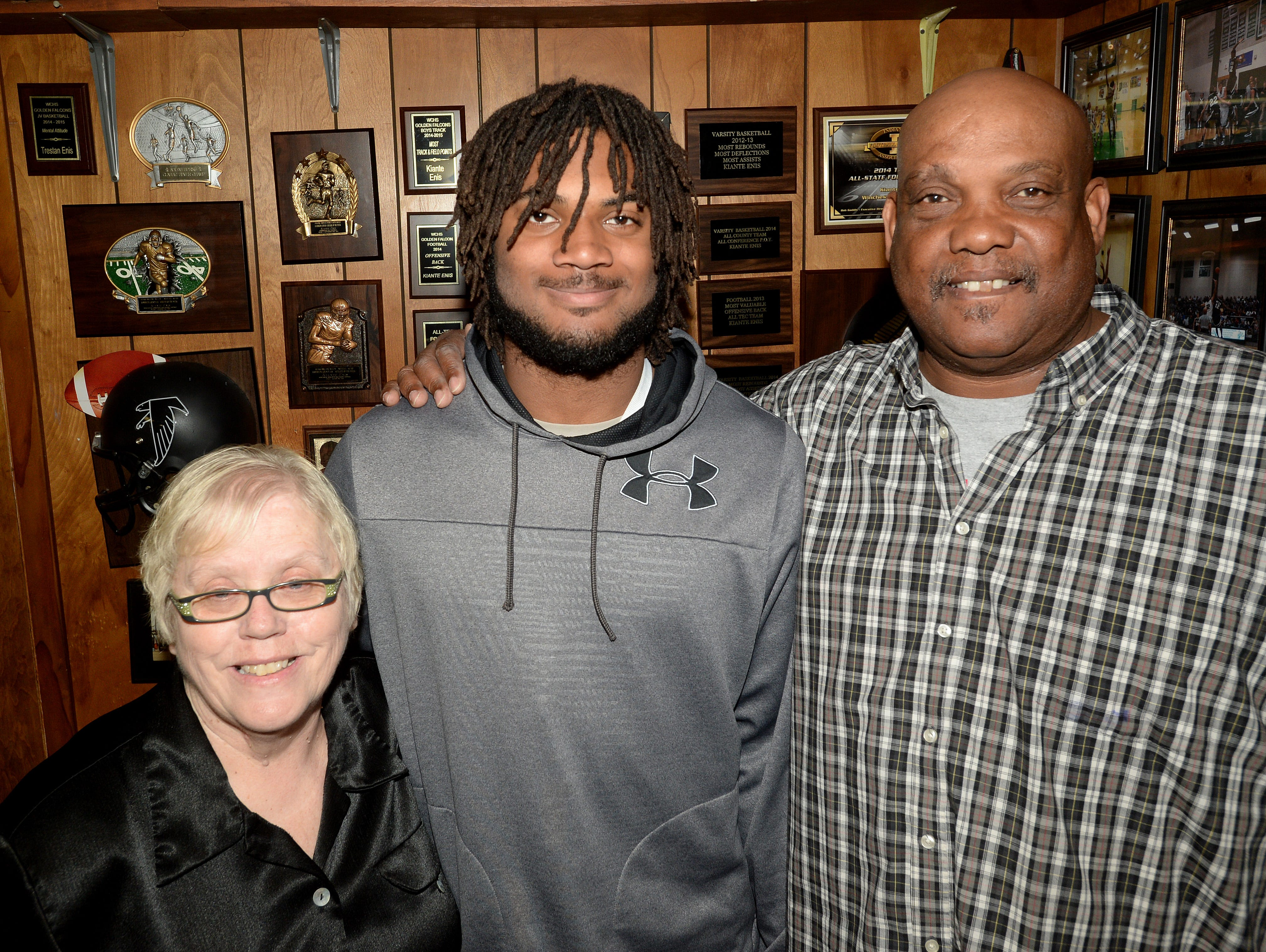Kiante Enis with grandmother Judy Enis, left, and grandfather Dwight, Saturday, April 30, 2016, at their home in Saratoga, Ind.