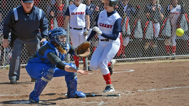 Allie Newcomb, who started the sixth inning with a pinch-hit single, scores the go-ahead run as Finlandia catcher Heather Grimm waiths for the ball as the Cougars beat Finlandia 5-1. Cleary beat the visiting Lions by the same score in the nightcap for the program's first-ever sweep.