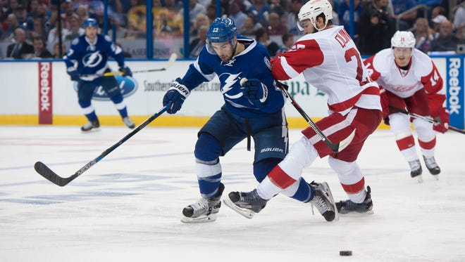 Tampa Bay's Cedric Paquette battles for the puck in Game 2.