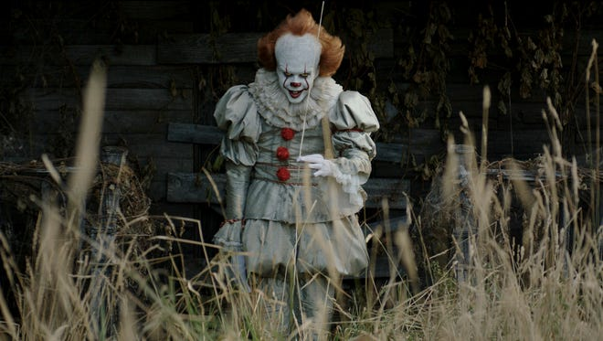 "This image released by Warner Bros. Pictures shows Bill Skarsgard in a scene from ""It."""