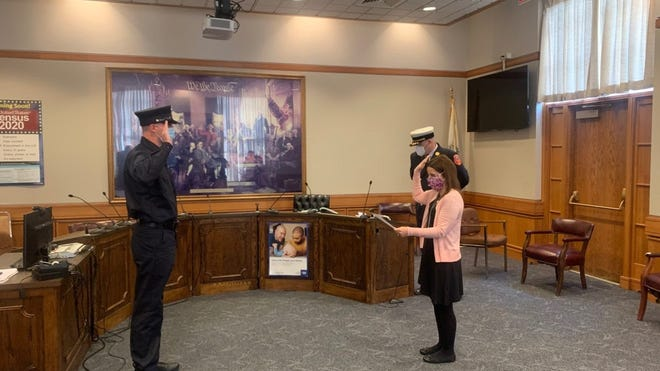 Firefighter Dominic DeSimone was sworn in by Town Clerk Maria Sagarino at a socially-distanced ceremony held at the Stoneham Town Hall.