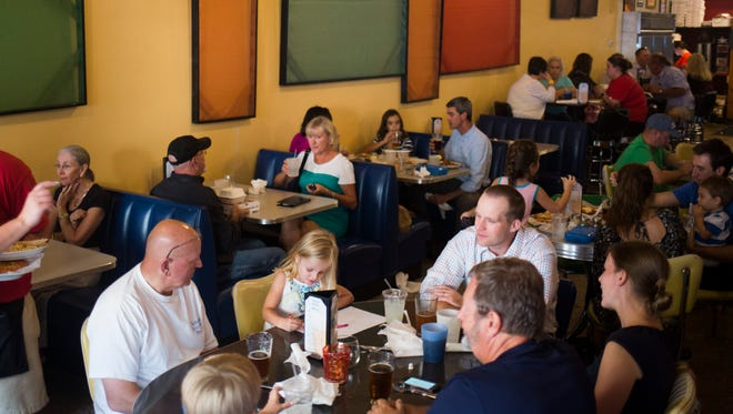 Many families eat at SummaJoe's during the restaurant's free pizza special for kids on Wednesday, September 7, 2016 in Anderson.