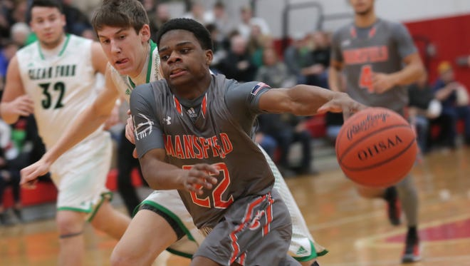 Mansfield Senior's Dontavios Burtin dribbles the ball past Clear Fork's AJ Blubaugh during a sectional game at Bucyrus High School on Friday night.