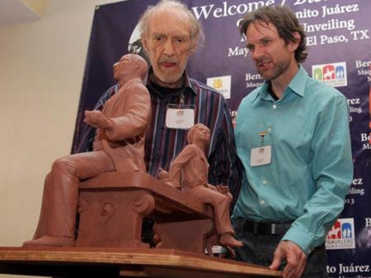 Artists and co-sculptors John Houser, left, and Ethan Houser unveil their Benito Juárez small-scale model in 2013.