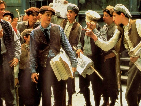 "The 1992 film ""Newsies"" is a movie-musical set in 1890s New York starring Christian Bale (center).   Walt Disney Pictures"