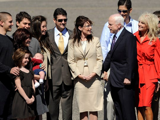 Republican presidential candidate Sen. John McCain, R-Ariz., is greeted at the airport by Republican vice presidential candidate Alaska Gov. Sarah Palin and her family, as well as Cindy McCain (right) and family, upon his arrival in Minneapolis on Sept. 3, 2008, to attend the Republican National Convention in St. Paul, Minnesota.