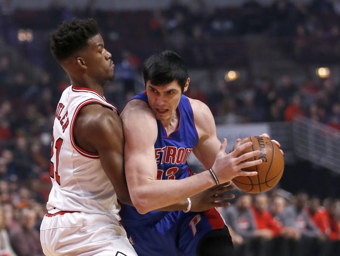 Chicago Bulls guard Jimmy Butler, left, defends against