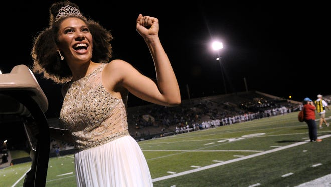 Cooper High School senior Cheyenne Sherwood rides past the student section in the back of a golf cart Friday nigh at Shotwell Stadium after being named the 2017 homecoming queen.