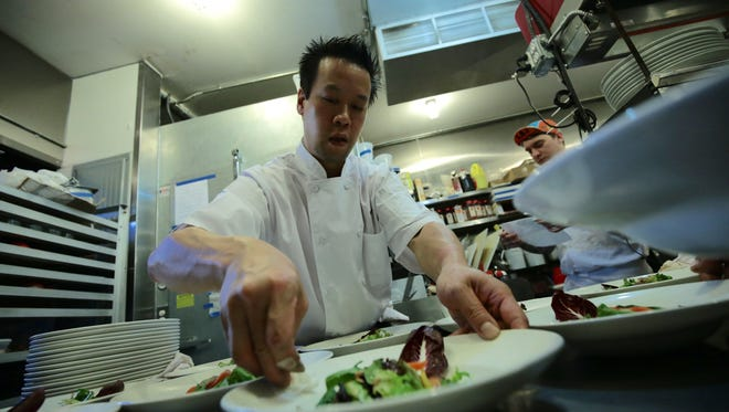 Chef Brion Wong plating a dish during the Detroit Free Press' Top 10 Takeover dinner series at the Antietam in Eastern Market, Detroit on Monday, July 13, 2015. Wong will open the Peterboro in Detroit on Thursday, March 17, 2016.