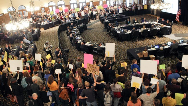 Protesters fill the Iowa Memorial Union during the Iowa Board of Regents meeting on Wednesday, Oct. 21, 2015.