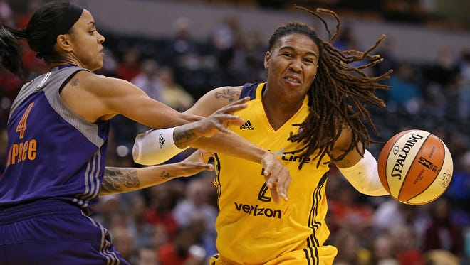 Phoenix Mercury forward Candice Dupree (4) fouls Indiana Fever forward Erlana Larkins (2) in the first quarter during an Indiana Fever game against Phoenix Mercury, Banker's Life Fieldhouse, Indianapolis, Wednesday, May 18, 2016.