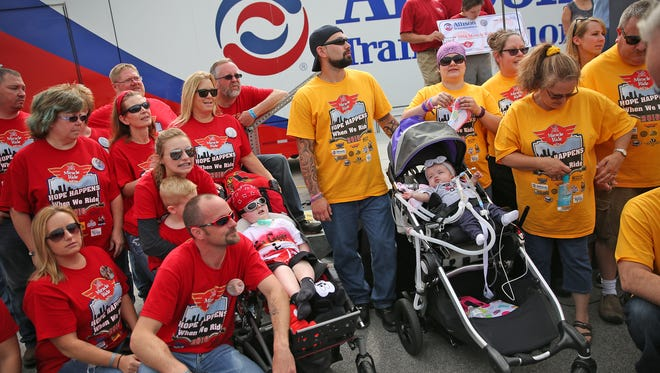 Riley Kids Gage Dreesen (left in chair) and Vivian Scott (right in chair) are joined by their teams and families during the opening ceremony of the 23rd Miracle Ride Sunday.