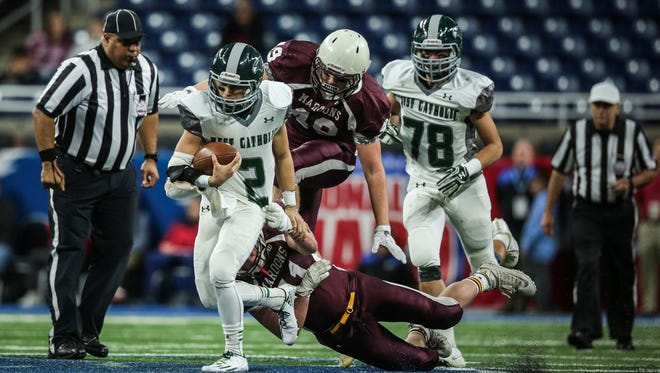 Grand Rapids West Catholic's Gaetano Vallone (2) runs the ball against Menominee during the Division 5 state title game on Saturday at Ford Field.