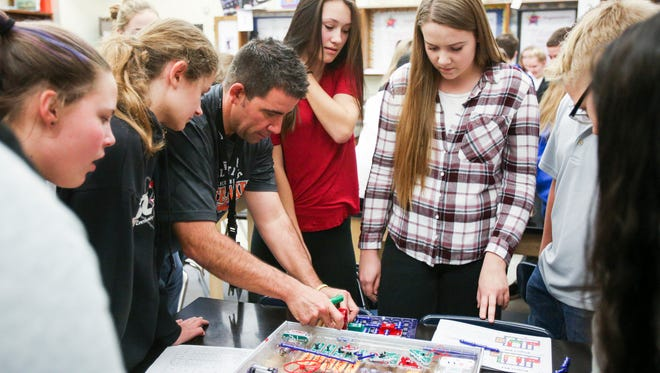 Whiteaker Middle School science teacher Brad Kilgroe helps students complete a circuit during an Hour of Code lesson on Friday, Dec. 9, 2016. Salem-Keizer made Oregon's top 10 list for districts that offer the highest max salary.