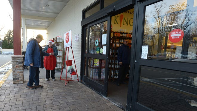 With a smile and always a kind word Eileen Scheibner a volunteer for the Salvation Army for over four years outside Kings Super market ringing a bell in the cold for a three hour shift. In certain areas the foot traffic is less  because of the popularity of online shopping and how this affects the Salvation Army, which relies on volunteers ringing bells in the hopes of donations from people when they go in or come out of a stores. In Morristown, NJ. December 19, 2016.