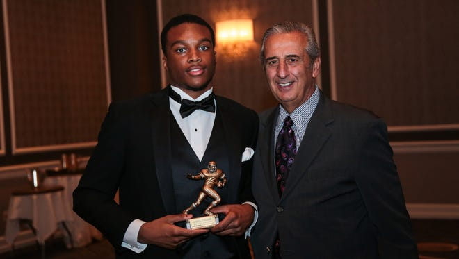 Ambry Thomas receives The Free Press 2016 All-State Dream Football Team Award from Tony Versaci, President, National Football Foundation, State of Michigan Chapter, at Dearborn Inn on Wednesday, February 15, 2017 in Dearborn, MI.