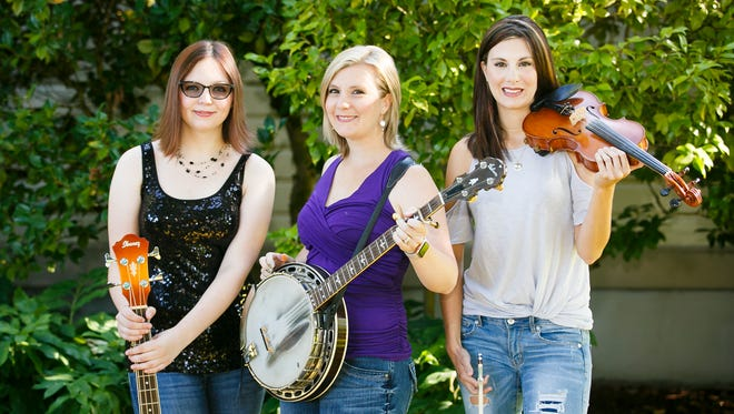 (Left to right) Haley Severin, Amy Severin and Heidi Severin make up The Severin Sisters, a bluegrass-pop group from Salem. Twins Heidi and Amy have been performing together since they were 15 and have been joined on stage in recent years by younger sister Haley.
