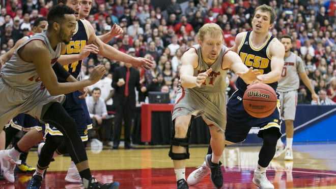 Western Oregon's Tanner Omlid (11) dives for a loose ball in a third round game against UC San Diego in the NCAA Division II Tournament on March 14, 2016.