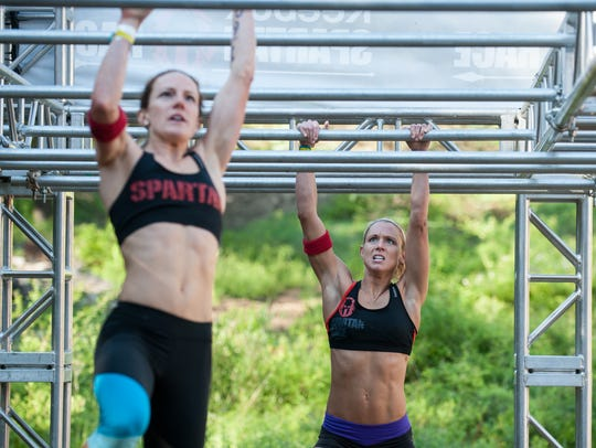 Competitors take part in a Spartan Race. The inaugural