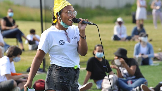 Janaysia Gethers of Weymouth welcomes the gathering to the Black Lives Matter vigil at Legion Field in Weymouth on Saturday, June 13, 2020. Tom Gorman/For The Patriot Ledger
