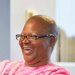 Because she lacked insurance, Esther Craig, 55, had a lump in her breast for months before she finally sought treatment. She has now completed treatment for Stage IV breast cancer.