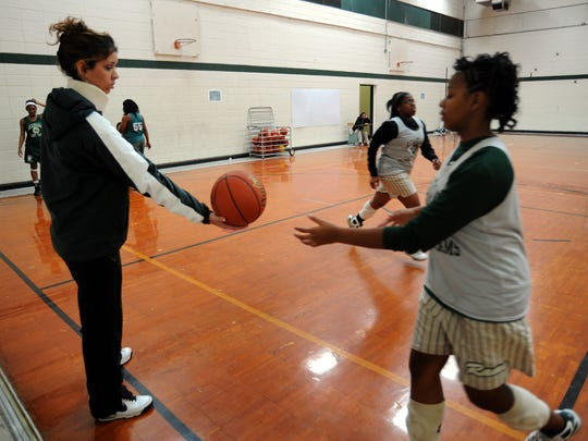 Catherine Cassidy works with Acadiana High girls' basketball