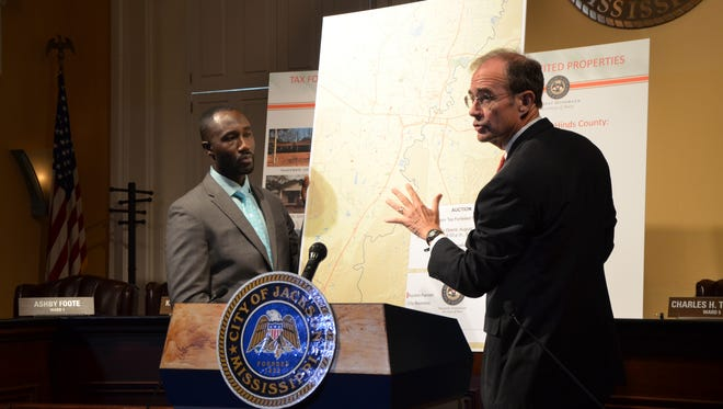 Jackson Mayor Tony Yarber (left) and Secretary of State Delbert Hosemann hold a news conference on Wednesday, August 26, 2015, at Jackson City Hall about the public auction of more than $14.6 million in tax-forfeited property in Jackson and Hinds County.