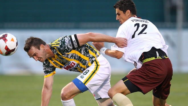 Rhinos Tyler Rosenlund fights for the ball with Sacramento's Nemanja Vukovic in the first half.