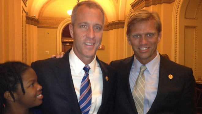 Rep. Sean Maloney, left, is pictured with his partner Randy Florke after a mock swearing in by House Speaker John Boehner, R-Ohio Jan. 3, 2013.